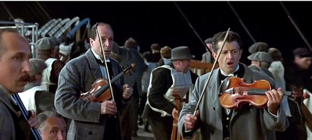 "Scene from Titanic ""Gentlemen it has been a privilege playing with you tonight""..... re Violin Jonathan Evans-Jones is a musician who plays Wallace Hartley in James Cameron 1997 film Titanic (on right of frame)"