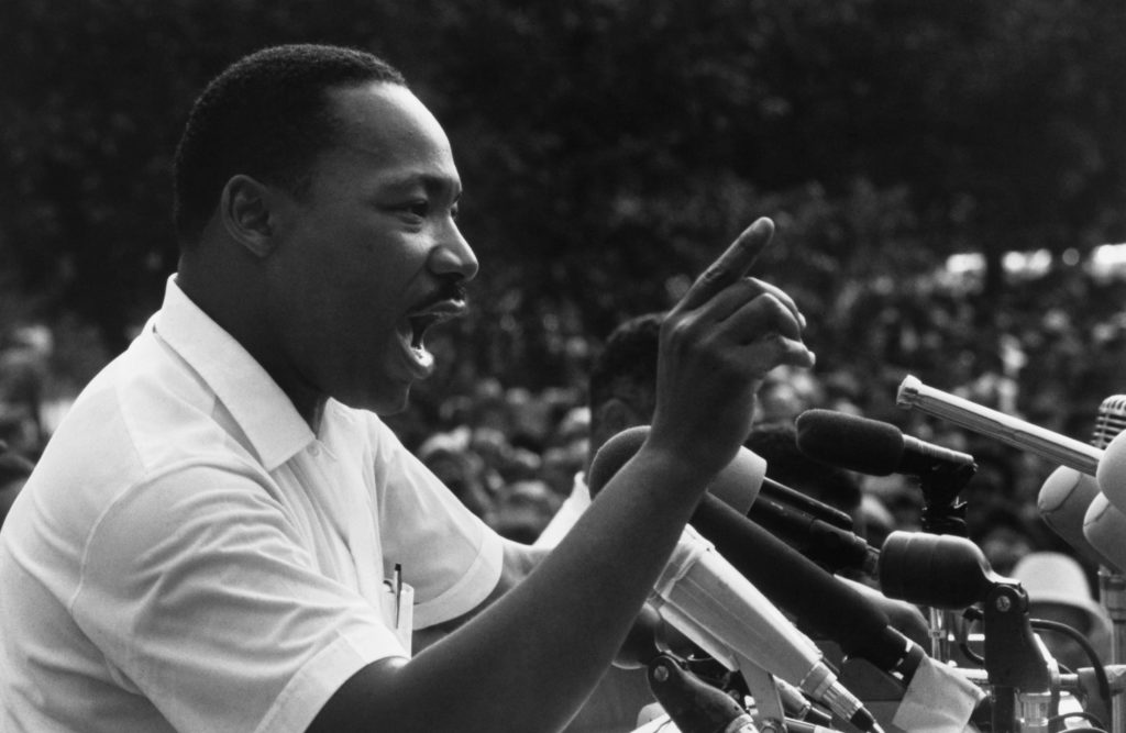 June 1966, Jackson, Mississippi, USA --- Martin Luther King Jr. speaks to a crowd at the March Against Fear rally on the steps of the Mississippi State Capitol. The march began in Memphis, Tennessee, by James Meredith, the first African American student at the University of Mississippi. --- Image by © Flip Schulke/CORBIS